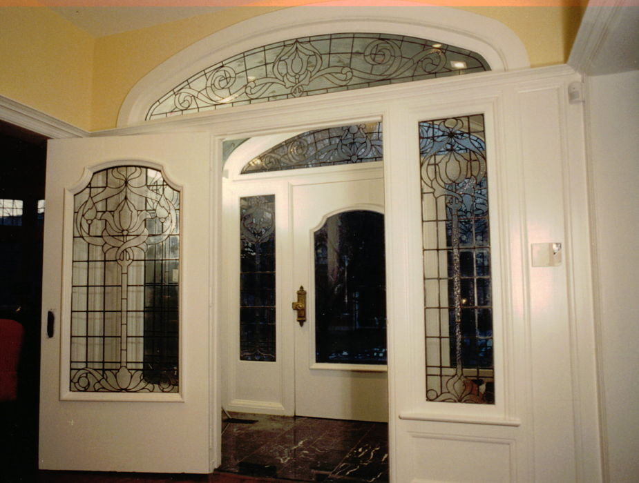 Traditional leaded glass windows in front entry