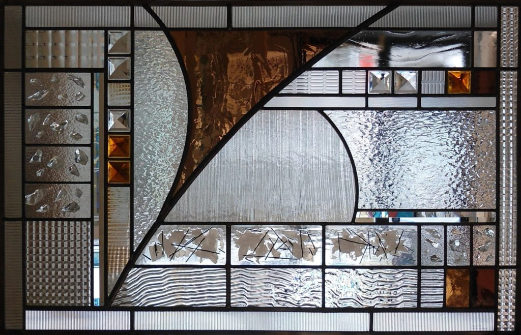 Stained glass abstract window with fused glass