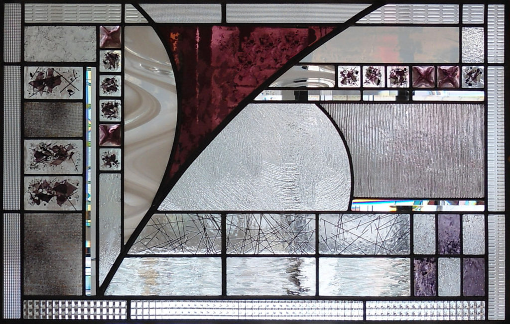 Abstract stained glass window by Thomas Smylie at The Glass Studio
