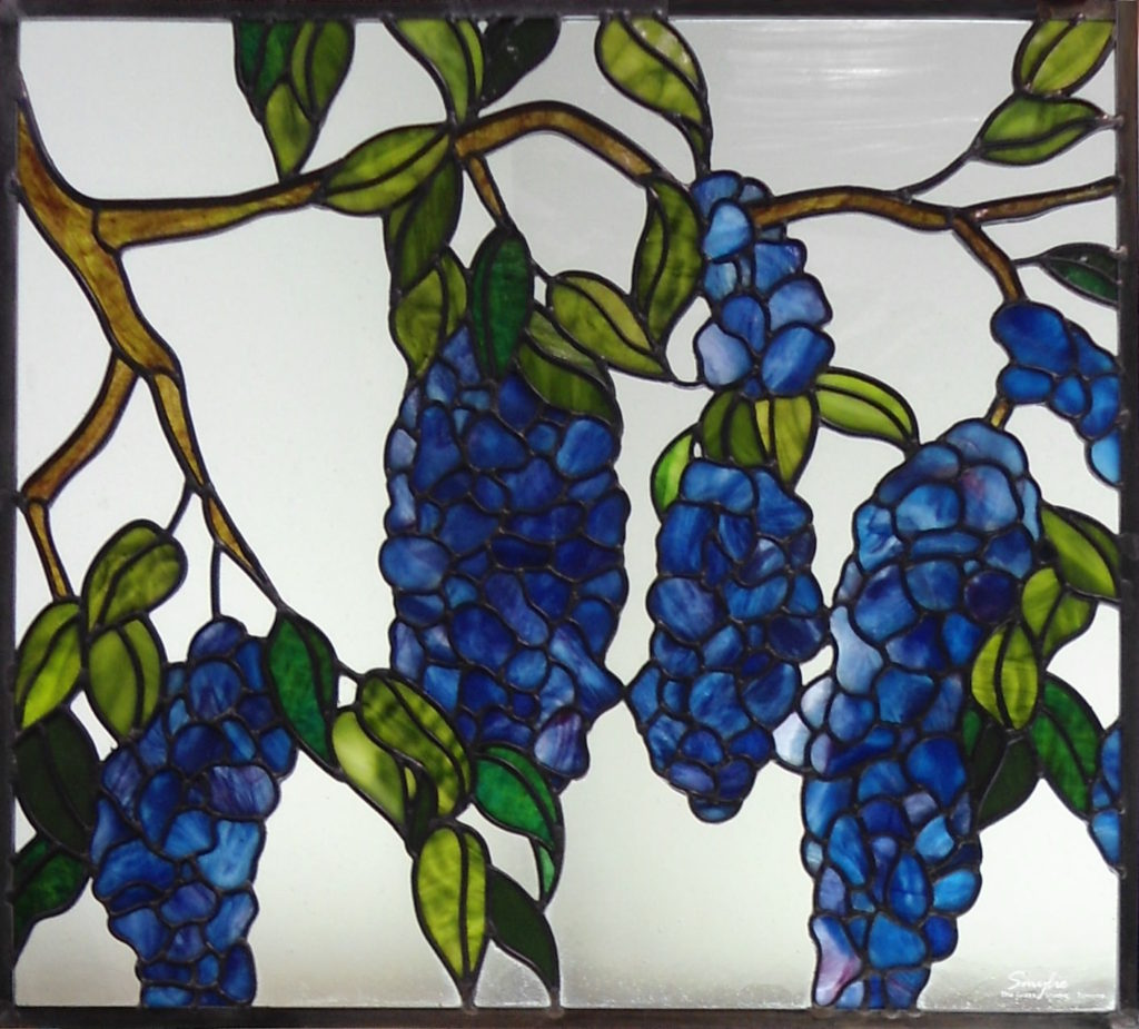 Stained glass wisteria blossoms and branches