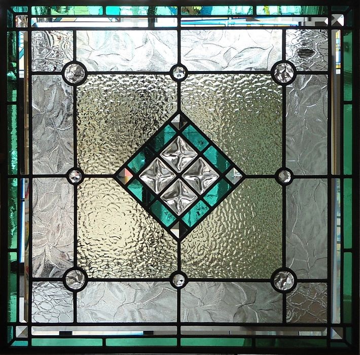Stained glass window with turquoise glass and cast jewels