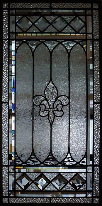 Leaded glass window with bevels and a fleur de lis centre motif