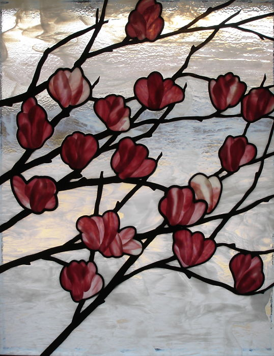 Stained glass window with fused magnolia blossoms