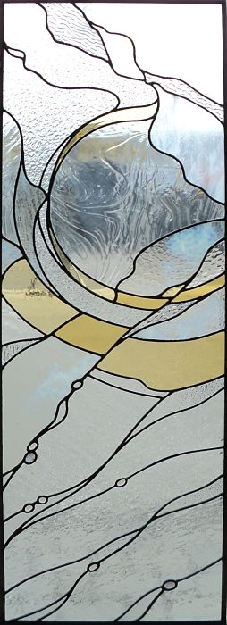Abstract stained glass window made with yellow and white glass