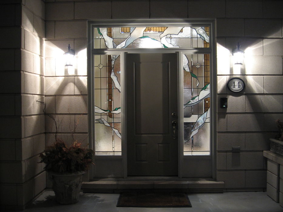 Abstract stained glass sidelights and transom