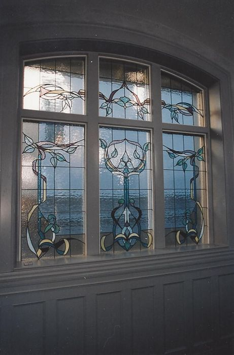 A six-panel stained glass window for a landing