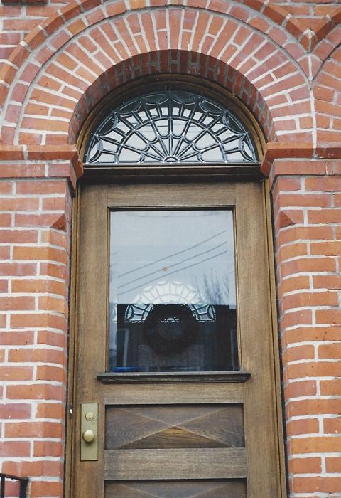 Leaded hand-bevelled glass transom over a front door