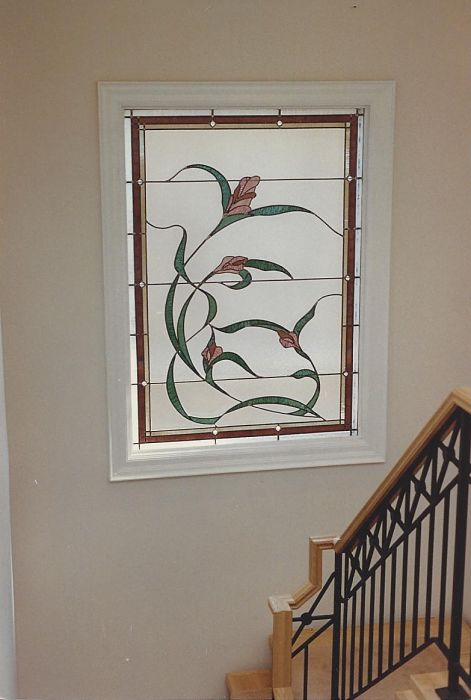 Art nouveau styled stained glass window in a stairway