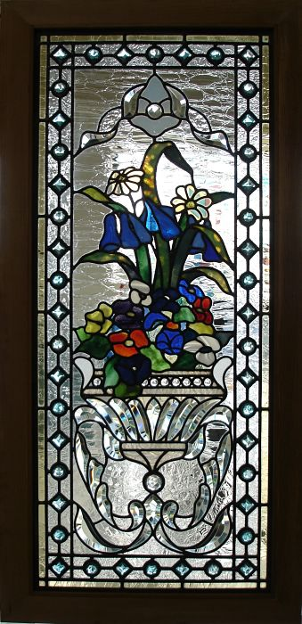Bevelled stained glass window with a flower basket design