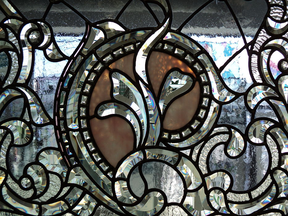 Close up detail of The Glass Studio's hand-bevelled glass window