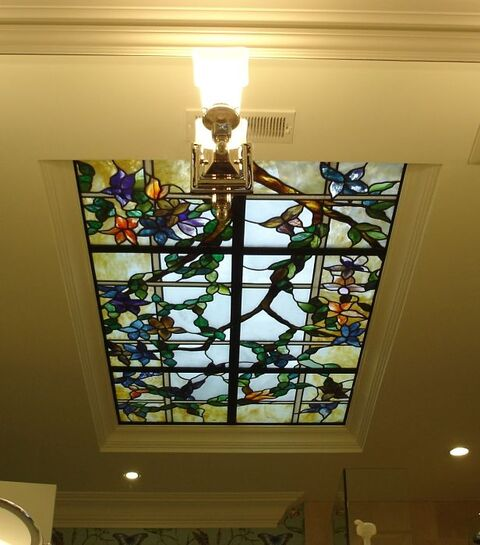 Floral themed stained glass ceiling in a bathroom