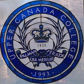 Round stained glass window Upper Canada College crest