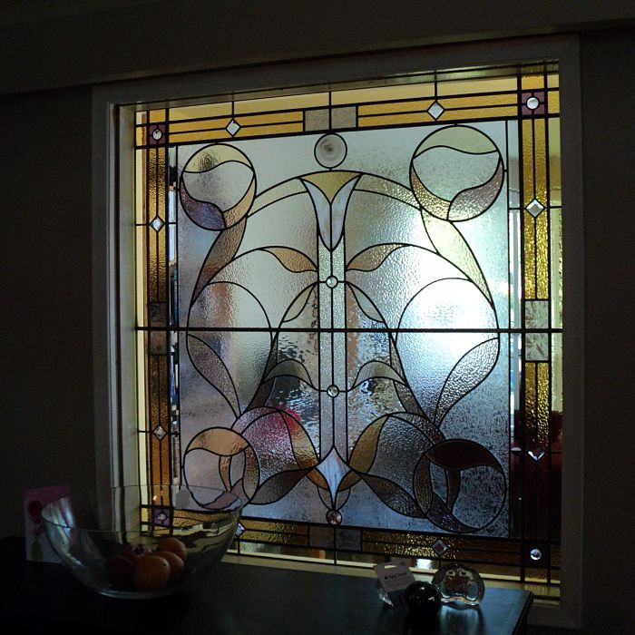 Stained glass window with amber and textural glass