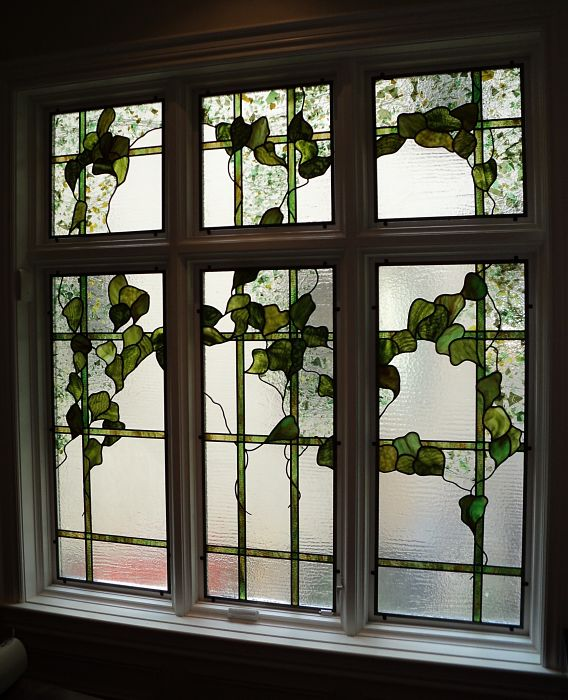 Stained glass window with a trellis ivy leaf design