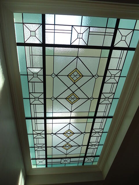 Geometric stained glass skylight ceiling with pale blue glass