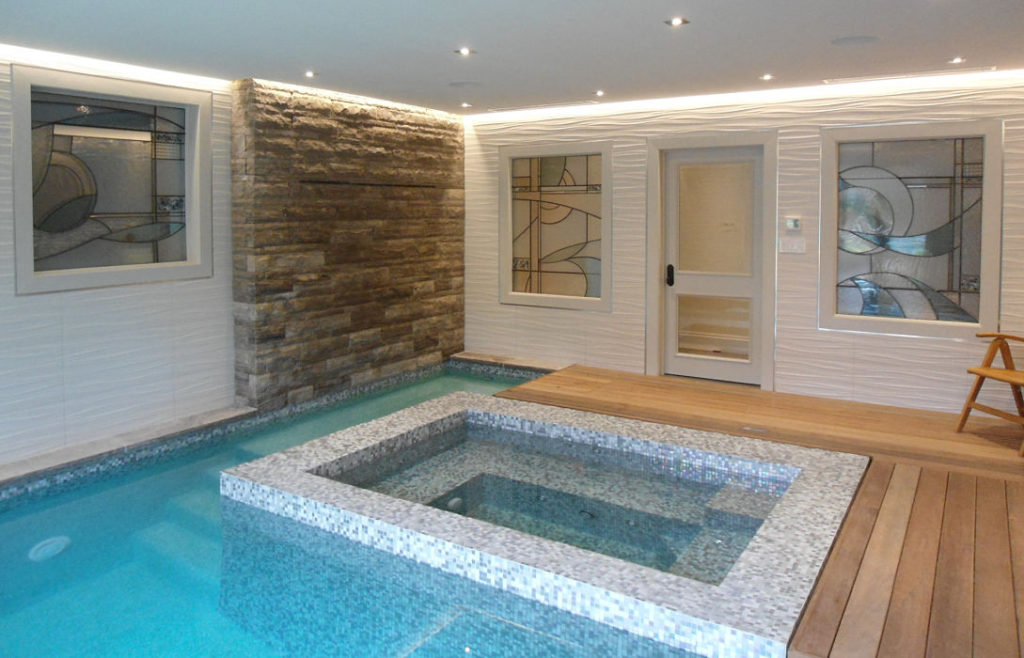Abstract stained glass windows in a pool/spa room