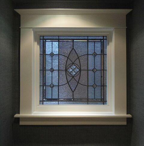 Leaded glass traditional window with cast jewels
