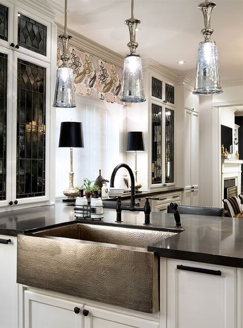 Kitchen with leaded glass cabinet panels