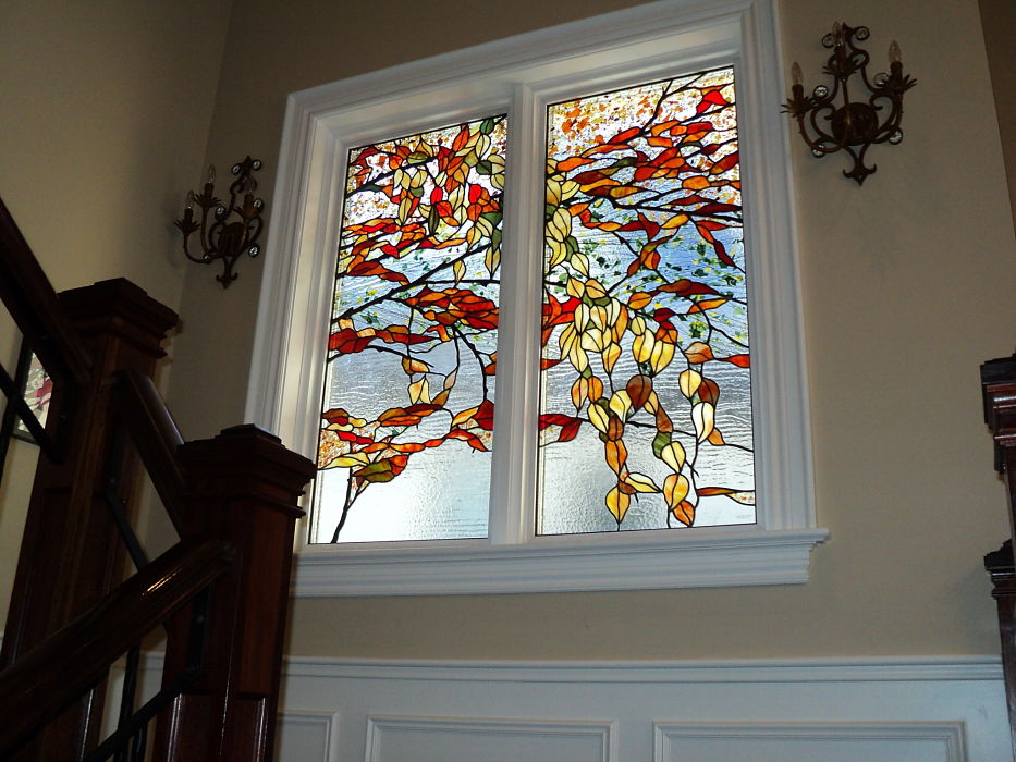 Stained glass windows with orange and yellow leaves