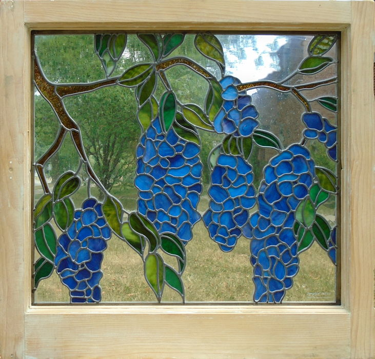 Stained glass wisteria blossoms by The Glass Studio