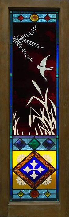 Stained glass window with swallow artwork by The Glass Studio