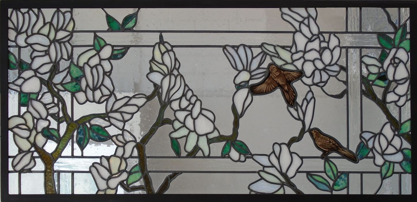 Stained glass window with painted birds by The Glass Studio