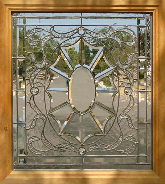 Bevelled and leaded glass window in a pine frame by The Glass Studio