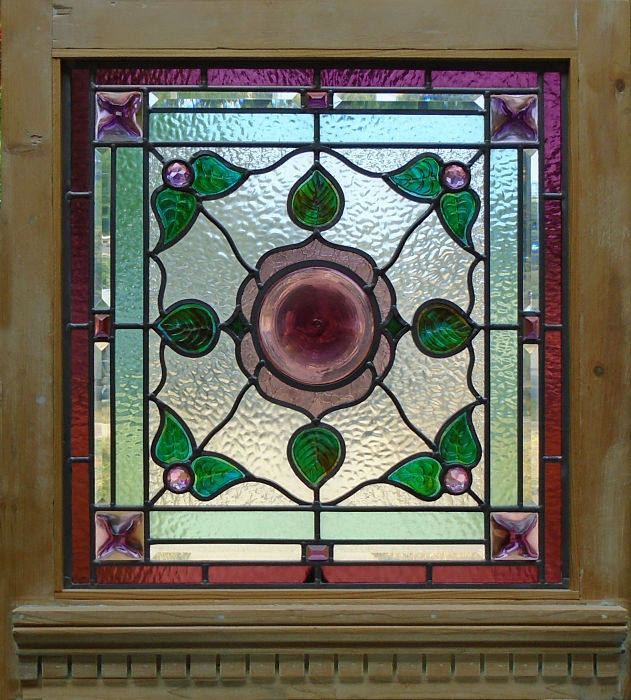 Stained glass window with rose rondel centre by The Glass Studio