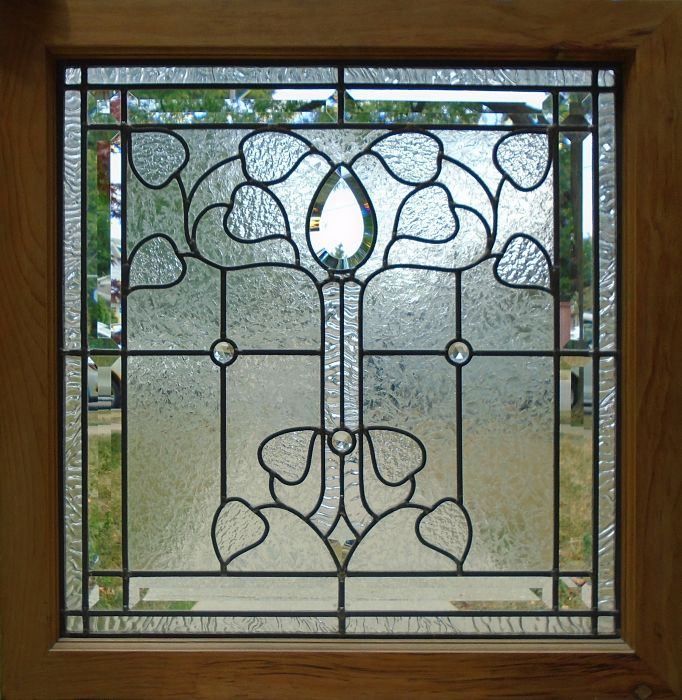 Leaded glass window with bevels by The Glass Studio