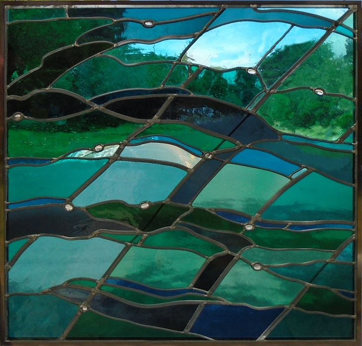 Abstract stained glass with blue and green by The Glass Studio