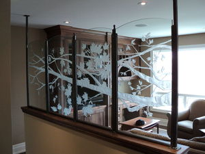 Carved glass divider screen featuring branches and leaves
