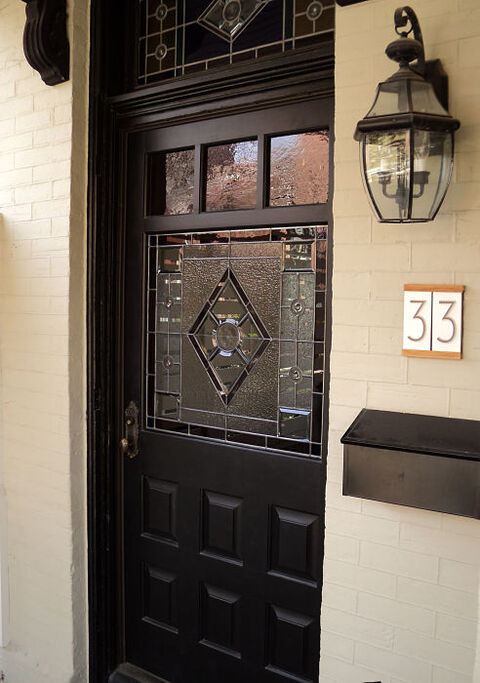 Front door entry with leaded glass window and transom