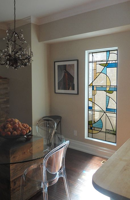 contemporary stained glass window in a dining room