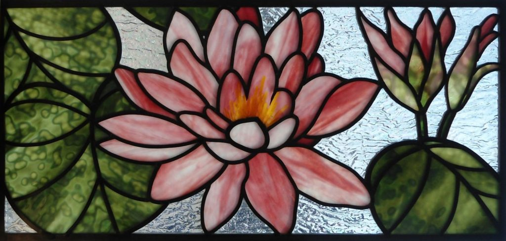 Stained glass window water lilly design with pink and green glass