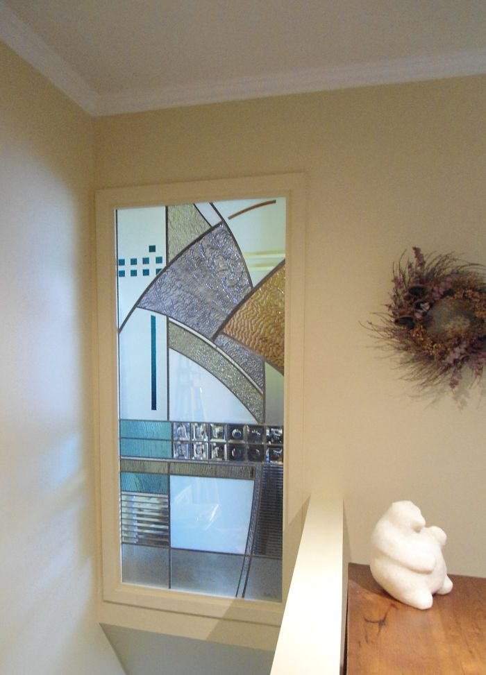 Contemporary stained glass window in a stairway