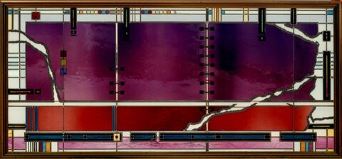 Abstract stained glass window with purple, red and blue glass