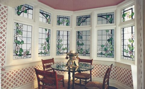 stained glass bay window with green leaves and trellis design