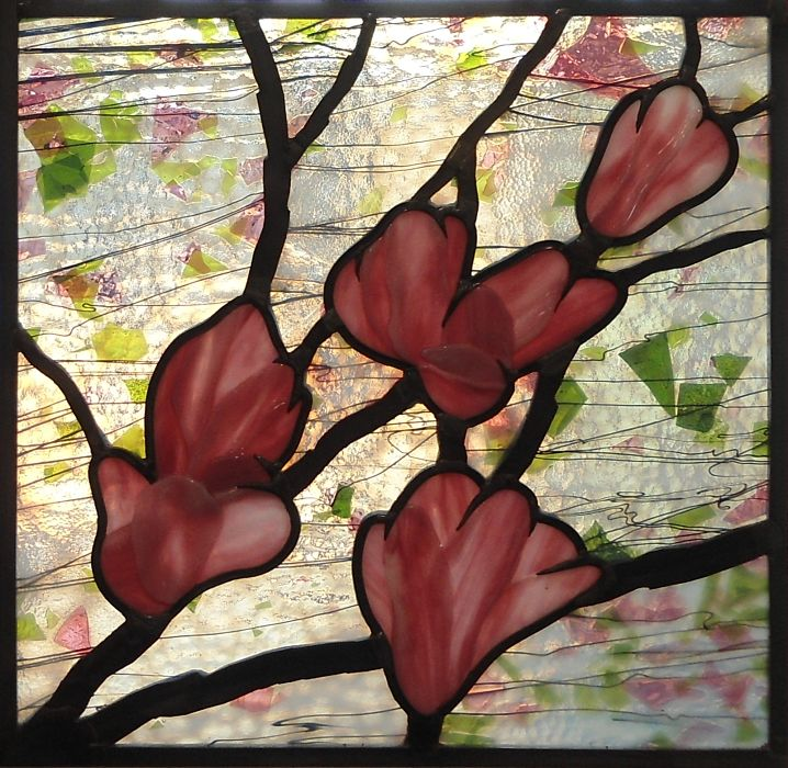 Stained glass with fused pink magnolia blossoms by The Glass Studio