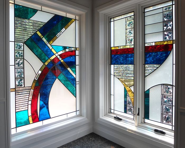 Stained glass windows with red, blue and white glass made by The Glass Studio