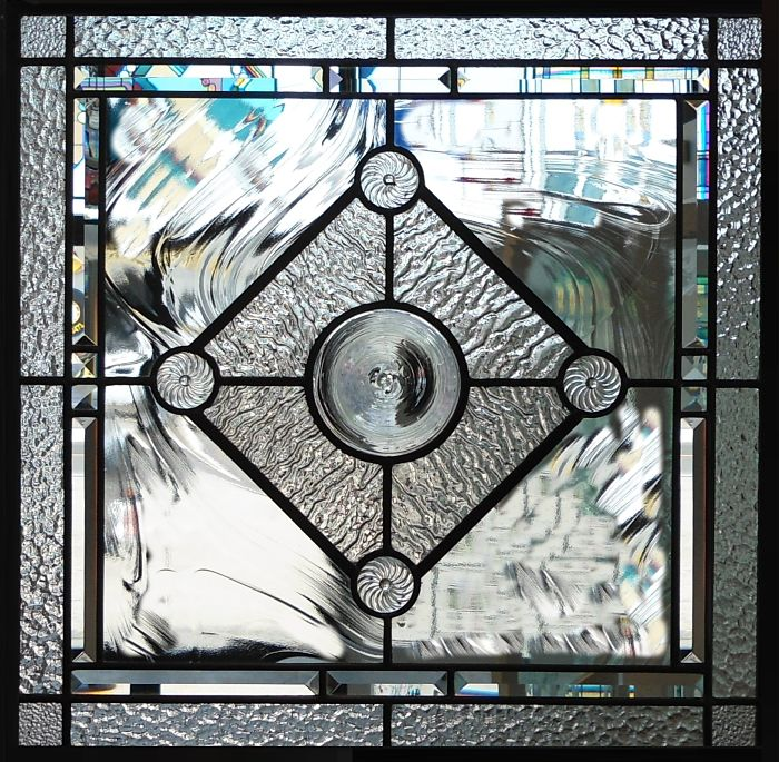 Leaded glass with a mouth-blown clear rondel centre