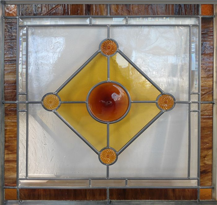 Leaded glass with an amber rondel by The Glass Studio