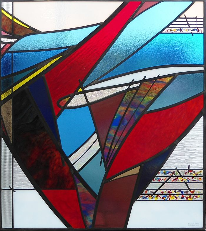 Red, blue and white stained glass abstract window by The Glass Studio Toronto