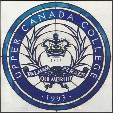 Round blue and white glass stained glass window Upper Canada College crest