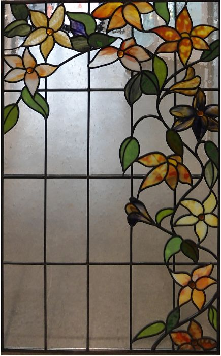 Stained glass flowers and leaves with mouth-blown background glass