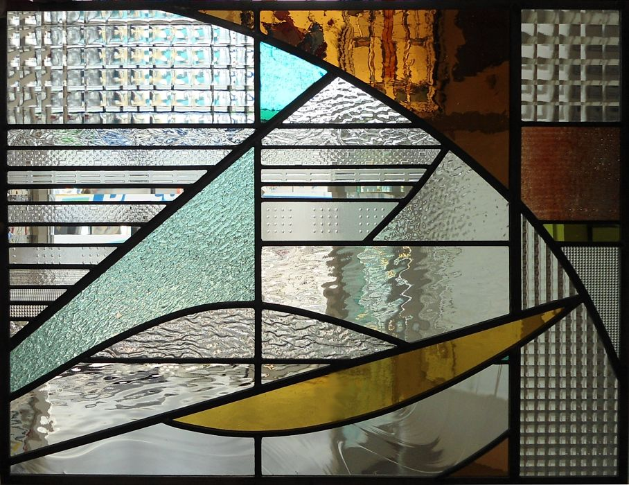 Stained glass window with mouth blown glass and textural glass