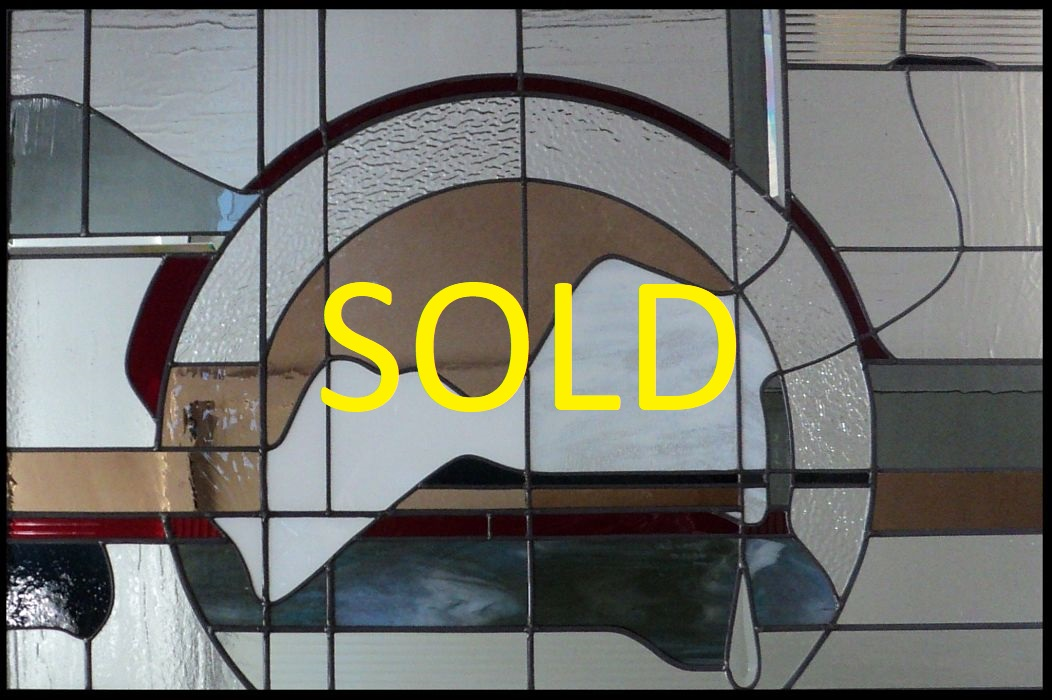 Abstract stained glass window with circular motif